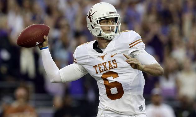 Texas quarterback Case McCoy (6)  passes during the first half of an NCAA college football game against TCU, Saturday, Oct. 26, 2013, in Fort Worth, Texas. (AP Photo/LM Otero)