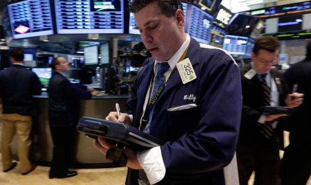 FILE - In this Tuesday, May 28, 2013, file photo, trader William McInerney works on the floor of the New York Stock Exchange. Global stock markets were mostly higher Thursday June 27, 2013 after the U.S. said quarterly growth may be weaker than expected, raising investors' hopes that the Federal Reserve would delay plans to wind down its stimulus program. (AP Photo/Richard Drew, File)
