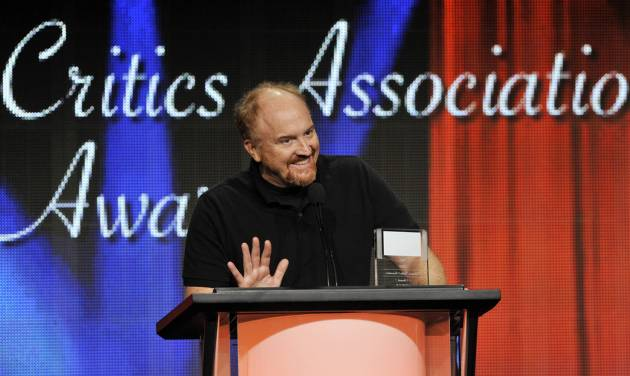 "FILE - Louis C.K. picks up the award for Individual Achievement in Comedy for his television series ""Louis"" at the 2013 TCA Awards at the Beverly Hilton Hotel on in this Aug. 3, 2013 file photo taken in Beverly Hills, Calif. Louie, who (like Louis) is a New York comic and a divorced father of two daughters, knows struggle and angst and cloudy wonderment. The fourth season kicks off Monday May 5, 2014. (Photo by Chris Pizzello/Invision/AP)"