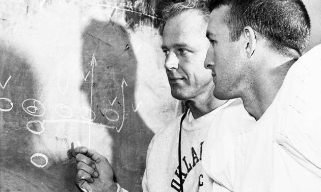 TOP: Former OU quarterback Jimmy Harris, right, shown with coach Bud Wilkinson in 1956. Harris said the reason he came to Oklahoma was because of Wilkinson. ABOVE: Harris in 1955. Harris quarterbacked two Sooner national championship teams: 1955 and 1956. AP AND THE OKLAHOMAN ARCHIVE PHOTOS