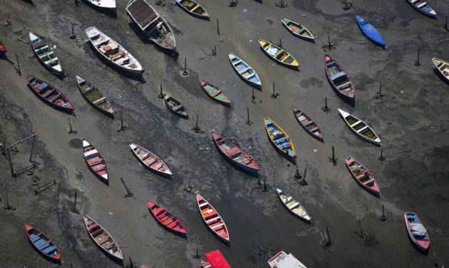 In this Nov. 19, 2013 file photo small boats sit on the shore of Guanabara Bay in the suburb of Sao Goncalo, across the bay from Rio de Janeiro, Brazil. Brazil will not make good on its commitment to clean up Rio de Janeiro's sewage-filled Guanabara Bay by the 2016 Olympic Games, state environmental officials acknowledged in a letter obtained Saturday May 17, 2014 by The Associated Press. (AP Photo/Felipe Dana, File)