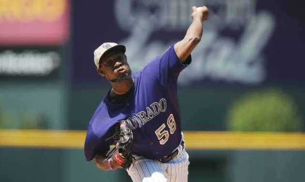 Colorado Rockies starting pitcher Yohan Flande works against the Los Angeles Dodgers in the first inning of a baseball game in Denver, Sunday, July 6, 2014. (AP Photo/David Zalubowski)