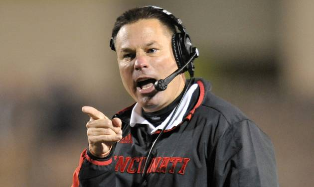 FILE - In this Oct. 20, 2012, file photo, Cincinnati Bearcats head coach Butch Jones yells during the second quarter of an NCAA college football game against the Toledo Rockets in Toledo, Ohio. The bowl-bound Bearcats wait to hear from coach Jones about whether he'll stay or head off to either Purdue or Colorado. (AP Photo/David Richard, File)