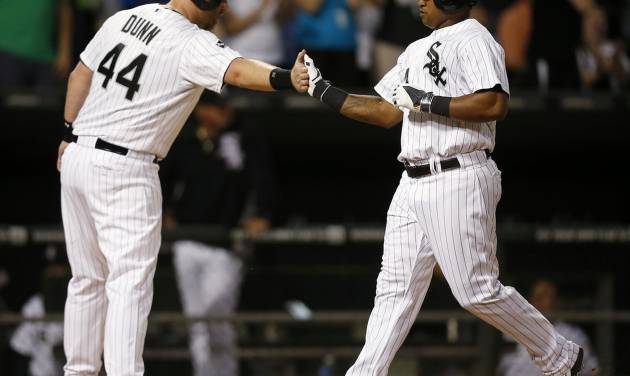 Chicago White Sox's Dayan Viciedo, right, celebrates his two-run home run against the San Francisco Giants with Adam Dunn, who scored, during the fifth inning of a baseball game on Tuesday, June 17, 2014, in Chicago. (AP Photo/Andrew A. Nelles)