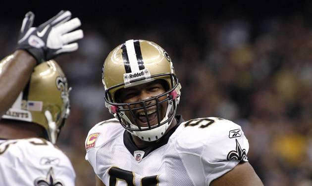FILE - In this Oct. 23, 2011, file photo, New Orleans Saints defensive end Will Smith (91) celebrates after pressuring Indianapolis Colts quarterback Curtis Painter during an NFL football game in New Orleans. The suspensions of Smith, Jonathan Vilma and two other players in the NFL's bounty investigation were lifted Friday, Sept. 7, 2012, by a three-member appeals panel and the league reinstated those players a few minutes later. The ruling does not permanently void their suspensions. (AP Photo/Jonathan Bachman, File)
