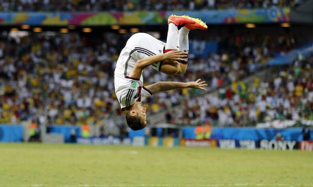 Germany's Miroslav Klose performs a flip as he celebrates after scoring his side's second goal during the group G World Cup soccer match between Germany and Ghana at the Arena Castelao in Fortaleza, Brazil, Saturday, June 21, 2014. (AP Photo/Frank Augstein)