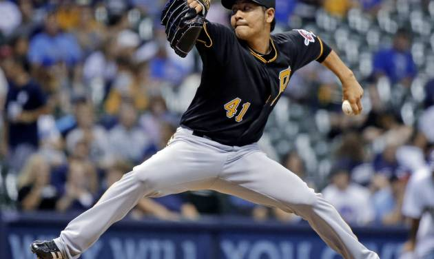 Pittsburgh Pirates relief pitcher Hisanori Takahashi throws during the eighth inning of a baseball game against the Milwaukee Brewers Friday, Aug. 31, 2012, in Milwaukee. (AP Photo/Morry Gash)