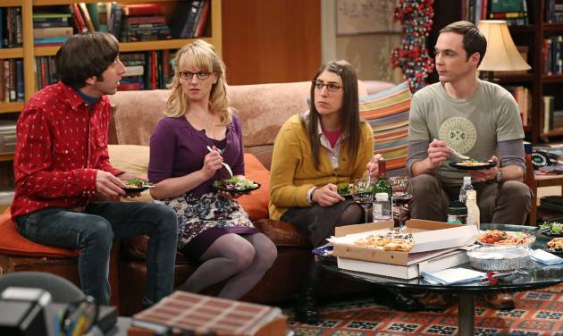 """FILE - This file image released by CBS shows, from left, Simon Helberg, Melissa Rauch, Mayim Bialik and Jim Parsons in a scene from """"The Big Bang Theory."""" CBS reports quarterly earnings on Thursday, May 8, 2014. (AP Photo/CBS, Michael Yarish, File)"""