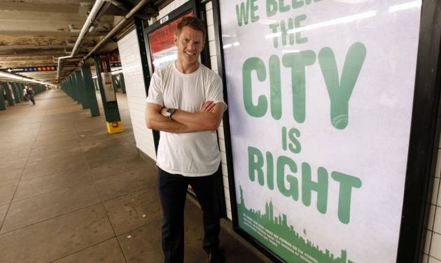 In this image provided by Zevia, Zevia CEO Paddy Spence stands in front of an ad from the company's new ad campaign in the New York City subway system, Tuesday, June 5, 2012 in New York. Zevia, which was founded in 2007, says it's now distributed in 42 percent of conventional supermarkets like Kroger and Safeway, as well as specialty chains such as Whole Foods. The privately held company would not say if it's yet profitable. (Photo by Jason Decrow/Invision for Zevia/AP Images)