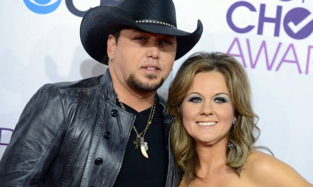 FILE - This Jan. 9, 2013 file photo shows Jason Aldean, left, and his wife Jessica at the People's Choice Awards at the Nokia Theatre in Los Angeles. Court papers filed April 26, show Aldean has filed for divorce from his wife Jessica Ussery.  (Photo by Jordan Strauss/Invision/AP, file)