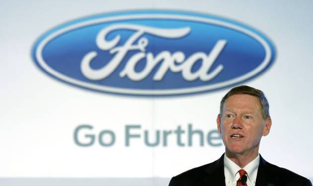 FILE - In this Oct. 21, 2013 file photo, Alan Mulally, president and CEO of Ford Motor Company speaks during a news conference in Hong Kong.  Ford CEO Alan Mulally said Tuesday, Jan 7, 2014 he will not leave the automaker for Microsoft and will stay at Ford at least through 2014. (AP Photo/Vincent Yu, File)