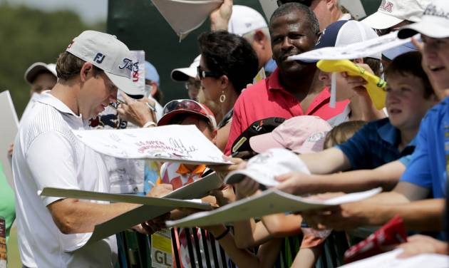 Erik Compton signs autographs after a practice round for the U.S. Open golf tournament in Pinehurst, N.C., Tuesday, June 10, 2014. The tournament starts Thursday. (AP Photo/Chuck Burton)