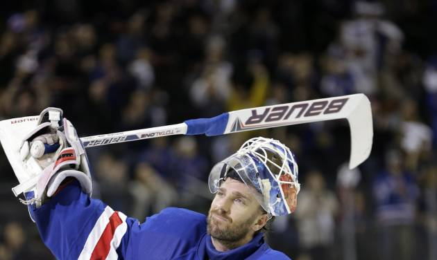 New York Rangers goalie Henrik Lundqvist, of Sweden, celebrates after defeating the Washington Capitals in Game 6 of their NHL Stanley Cup hockey playoff series in New York, Sunday, May 12, 2013. The Rangers evened the series at 3-3 with a 1-0 shutout, forcing a Game 7 in Washington, Monday. (AP Photo/Kathy Willens)