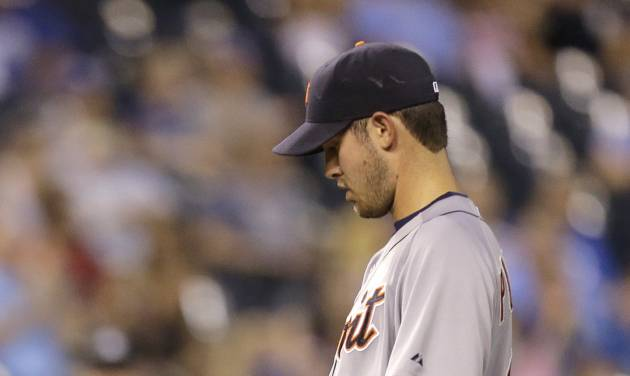 Detroit Tigers starting pitcher Rick Porcello collects himself after loading the bases during the fifth inning of a baseball game against the Kansas City Royals, Thursday, Aug. 30, 2012, in Kansas City, Mo. (AP Photo/Charlie Riedel)