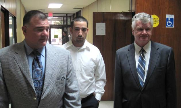 """FILE - In this Oct. 22, 2010, file photo, former Winnfield Police Officer Scott Nugent, center, walks with his attorneys Phillip Terrell, left and George Higgins in the Winn Parish Courthouse in Winnfield, La. Nugent was acquitted by a jury in 2010 of manslaughter in the Taser death of Baron """"Scooter"""" Pikes. The Supreme Court could take its first look at police use of Taser stun guns in a case involving the death of Pikes who was shocked by police eight times after he had been placed in handcuffs. The justices could say as early as Monday, May 19, 2014, whether they will add the case of Pikes to their fall calendar. The court is being asked to review a federal appeals court ruling that dismissed a civil rights lawsuit filed on behalf of Pikes' young son against the former police officer. (AP Photo/The Daily Town Talk, Billy Gunn, File)  NO SALES"""