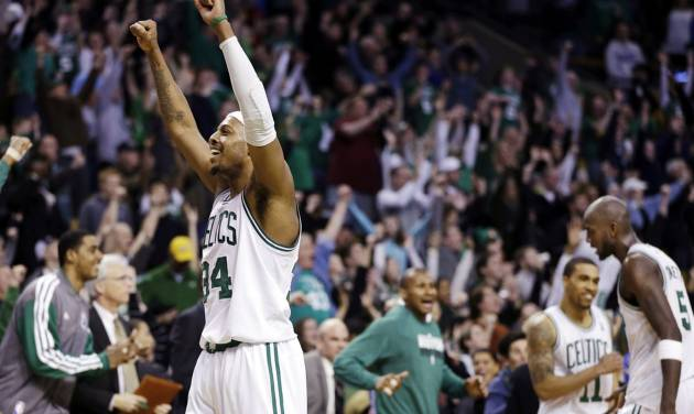 Boston Celtics forward Paul Pierce (34) reacts to the crowd after they defeated the Denver Nuggets 118-114 in triple overtime in an NBA basketball game in Boston, Sunday, Feb. 10, 2013. (AP Photo/Elise Amendola)