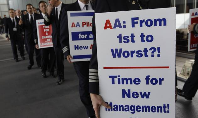 FILE-In this Thursday, Sept. 20, 2012, file photo, over 200 American Airline pilots march on a picket line at O'Hare International in Chicago, Ill. A federal appeals court has ruled against American Airlines, which tried to block a union election among nearly 10,000 employees. The 5th U.S. Circuit Court of Appeals in New Orleans overturned a district court judge's ruling in American's favor. The appeals court said Wednesday, Oct. 3, 2012, that the judge didn't have grounds to invalidate a federal panel's decision to schedule an election among American's passenger-service agents. (AP Photo/M. Spencer Green, FIle)