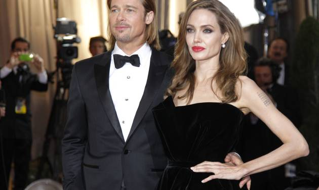 FILE - In this Feb. 26, 2012 file photo, actress Angelina Jolie, right, and actor Brad Pitt arrive before the 84th Academy Awards in the Hollywood section of Los Angeles. Pitt's manager Cynthia Pett-Dante confirmed their engagement on Friday April 13, 2012. (AP Photo/Amy Sancetta, file)