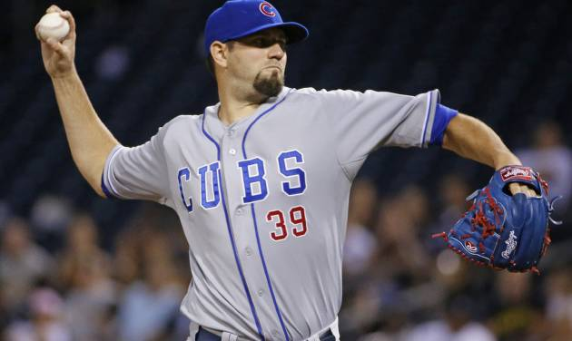 Chicago Cubs starting pitcher Jason Hammel delivers during the first inning of a baseball game against the Pittsburgh Pirates in Pittsburgh Wednesday, June 11, 2014. (AP Photo/Gene J. Puskar)