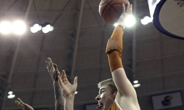Texas forward Connor Lammert (21) shoots against TCU forward Connell Crossland (2) during the first half of an NCAA college basketball game Tuesday, Feb. 19, 2013, in Fort Worth, Texas. (AP Photo/LM Otero)