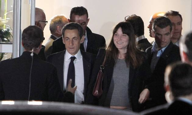 President and conservative candidate for re-election, Nicolas Sarkozy, center left, and his wife Carla Bruni-Sarkozy, center right, leave a TV studio after his campaign debate, in Saint-Denis, outside Paris, Wednesday May 2, 2012. France's presidential race hit a dramatic pitch Wednesday in the only face-to-face debate between President Nicolas Sarkozy and front-running challenger Francois Hollande - a verbal slugfest that broke little new ground on substance but exposed big differences in style. (AP Photo/Thibault Camus)
