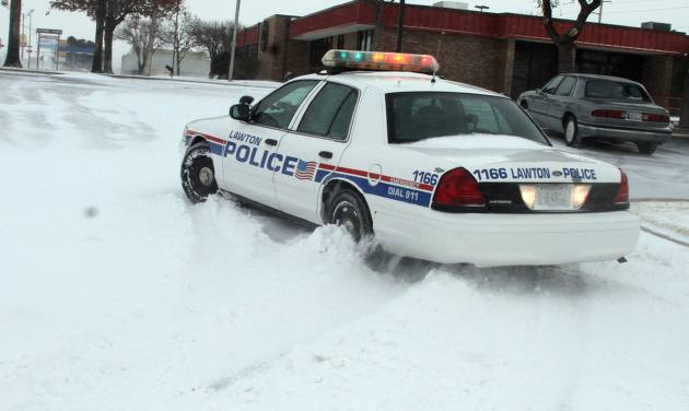 A Lawton, Okla., police cruiser tries to navigate the snow as blizzard conditions hit southwest Oklahoma at midday Tuesday, Dec. 25, 2012. (AP Photo/The Lawton Constitution, Brandon Neris)