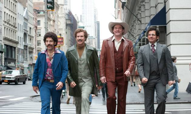 """This image released by Paramount Pictures shows, from left, Paul Rudd is Brian Fantana, Will Ferrell is Ron Burgundy, David Koechner is Champ Kind and Steve Carell is Brick Tamland in a scene from """"Anchorman 2: The Legend Continues."""" (AP Photo/Paramount Pictures, Gemma LaMana)"""