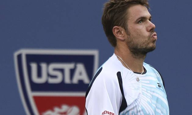Stan Wawrinka, of Switzerland, reacts after a shot against Kei Nishikori, of Japan, during the quarterfinals of the 2014 U.S. Open tennis tournament, Wednesday, Sept. 3, 2014, in New York. (AP Photo/Mike Groll)