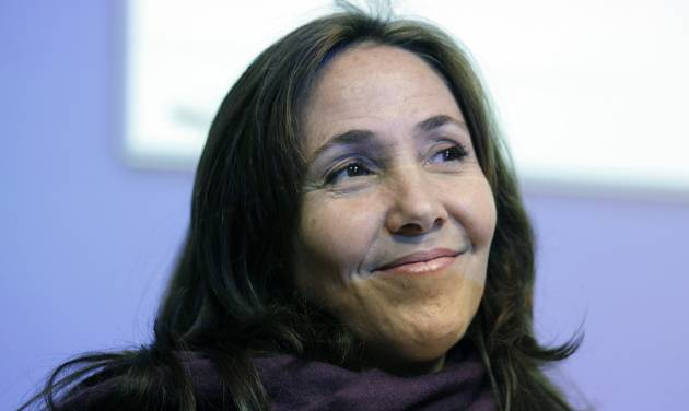 Mariela Castro, daughter of Cuban President Raul Castro, smiles before speaking to an academic conference at San Francisco General Hospital in San Francisco, Wednesday, May 23, 2012. Castro, an outspoken gay rights advocate, spoke at a medical lecture for health care providers on care for transgender patients. (AP Photo/Eric Risberg)