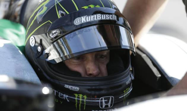 Race driver Kurt Busch practices at the Indianapolis Motor Speedway during the Rookie Orientation Program in Indianapolis, Tuesday, April 29, 2014. Busch will try to be the first driver in a decade to compete in IndyCar's Indianapolis 500 and Sprint Cup's Coca-Cola 600 on the same day. (AP Photo/Michael Conroy)