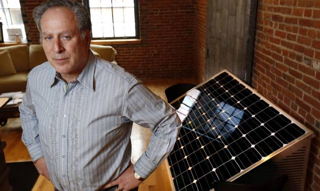This photo taken Jan. 20, 2014, shows Barry Shear, president of Eagle Point Solar, with one of his company's solar panels inside their Dubuque, Iowa, office.  Eagle Point Solar is involved in a case over solar power going to the Iowa Supreme Court. (AP Photo/The Des Moines Register, Christopher Gannon)