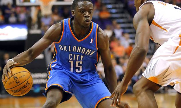 Oklahoma Thunder guard Reggie Jackson (15) drives against Phoenix Suns' Eric Bledsoe during the first half of an NBA preseason basketball game, Tuesday, Oct. 22, 2013, in Phoenix. (AP Photo/Matt York)
