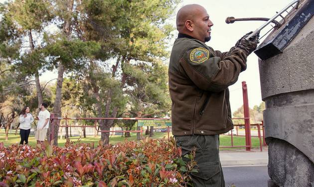 Orange County Parks grounds keeper Frank Amaro removes the supports to the sign at the entrance of Ralph B. Clark Regional Park in Buena Park in Fullerton, Calif.,  on Saturday, March 29, 2014,  morning after rangers discovered it fell off it's supports after an earthquake hit Orange County Friday night.   More than 100 aftershocks have rattled Orange County south of Los Angeles where a magnitude-5.1 earthquake struck Friday.  Despite the relatively minor damage, no injuries have been reported. (AP Photo/The Orange County Register, Ken Steinhardt)   MAGS OUT; LOS ANGELES TIMES OUT