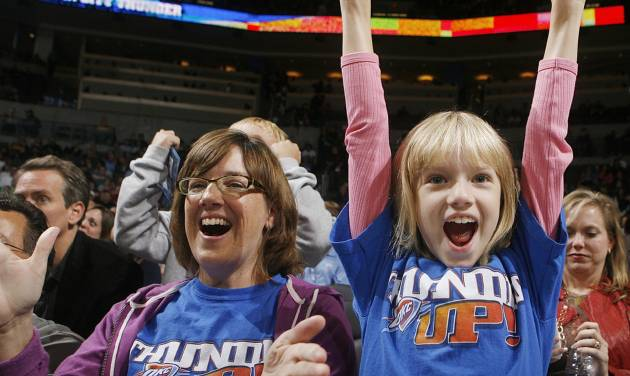 Anne Seys and her daughter Amelia cheer on the Thunder during the preseason NBA basketball game between the Oklahoma City Thunder and the Phoenix Suns at the Ford Center on Monday, Oct. 12, 2009, in Oklahoma City, Okla. Photo by Chris Landsberger, The Oklahoman.
