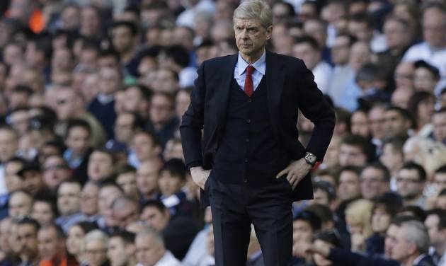 Arsenal's manager Arsene Wenger watches his team play from the technical area during the English Premier League soccer match between Tottenham Hotspur and Arsenal at White Hart Lane stadium in London, Sunday, March 16, 2014. (AP Photo/Matt Dunham)