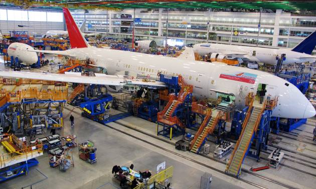 FILE - In this Thursday, Dec. 19, 2013, file photo, workers assemble Boeing 787 Dreamliners in the company's massive assembly plant in North Charleston, S.C.  Boeing reports quarterly financial results on Wednesday, Jan. 29, 2014. (AP Photo/Bruce Smith, File)