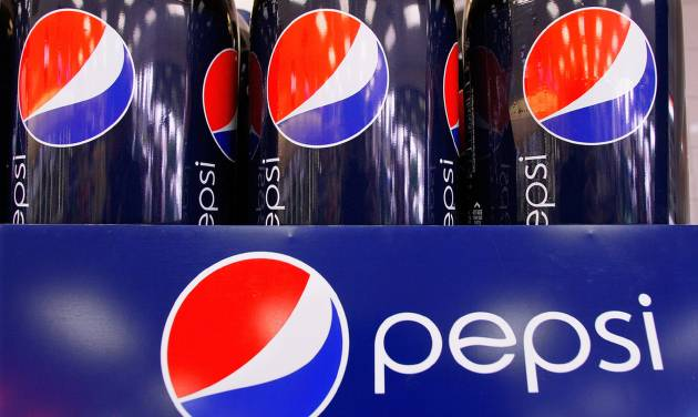 FILE - This Feb. 9, 2011 file photo shows bottles of Pepsi at a grocery store in Springfield, Ill. PepsiCo reports quarterly financial results Wednesday, July 23, 2014. (AP Photo/Seth Perlman, File)