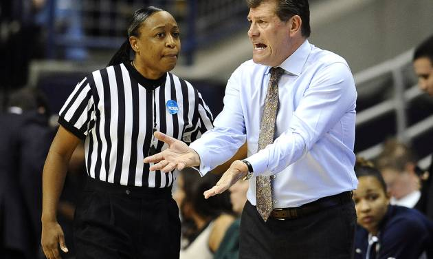Connecticut head coach Geno Auriemma, right, speaks with official Felicia Grinter in the first half of a second-round game in the women's NCAA college basketball tournament in Storrs, Conn., Monday, March 25, 2013. Connecticut won 77-44. (AP Photo/Jessica Hill)