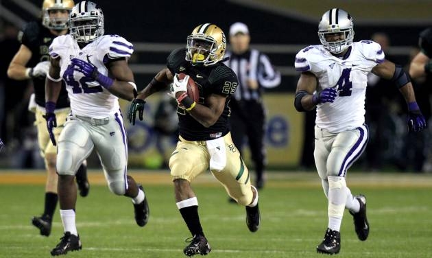 Baylor running back Lache Seastrunk (25) breaks away on a touchdown run against Kansas State defensive end Meshak Williams (42) and linebacker Arthur Brown (4) during the third quarter of an NCAA college football game, Saturday, Nov. 17, 2012, in Waco Texas. (AP Photo/LM Otero)