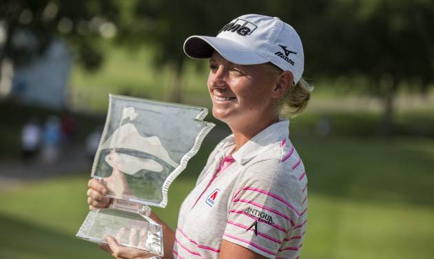 Stacy Lewis holds the trophy following the final round of the NW Arkansas Championship golf tournament on Sunday, June 29, 2014, in Rogers, Ark. (AP Photo/Beth Hall)