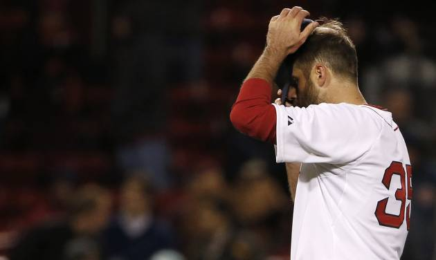 Boston Red Sox relief pitcher Burke Badenhop adjusts his cap after giving up the go-ahead run during the eleventh inning of a baseball game against the Milwaukee Brewers at Fenway Park in Boston, Saturday, April 5, 2014. (AP Photo/Winslow Townson)