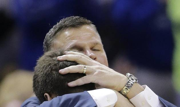 Creighton head coach Greg McDermott hugs his son Doug McDermott (3) as he leaves the game during the final moments in the second half of a third-round game against Baylor in the NCAA college basketball tournament Sunday, March 23, 2014, in San Antonio. Baylor won 85-55. Creighton's Will Artino is at left. (AP Photo/Eric Gay)