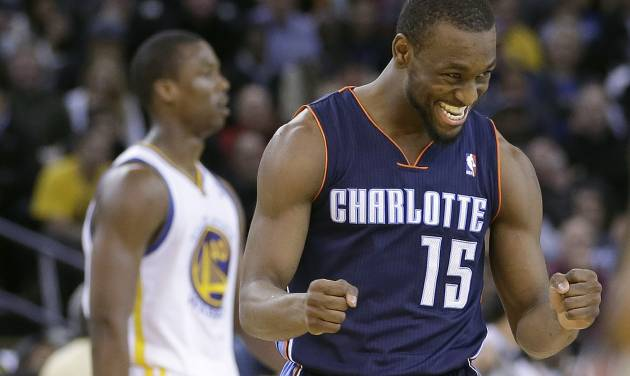 Charlotte Bobcats' Kemba Walker (15) celebrates after scoring against the Golden State Warriors during the second half of an NBA basketball game in Oakland, Calif., Tuesday, Feb. 4, 2014. The Bobcats won 91-75. (AP Photo/Tony Avelar)