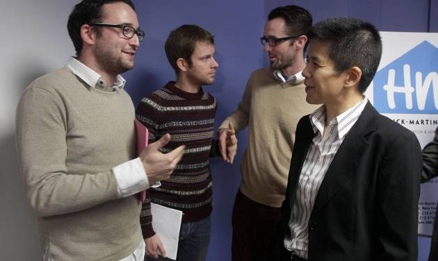"Chaim Levin, left, talks with Christine Sun, right, deputy legal director for the Southern Poverty Law Center, as Michael Ferguson, background right, stands with his partner Seth Anderson, after a news conference, in New York, Tuesday, Nov. 27, 2012. Levin, of the Crown Heights neighborhood of Brooklyn. NY, and Ferguson, of Salt Lake City, who are gay, are accusing a New Jersey organization of selling ""conversion therapy"" services promising to make them straight. Instead, they told the news conference that they were subjected to humiliations, including having to strip naked, or taking a baseball bat to effigies of their mothers. (AP Photo/Richard Drew)"