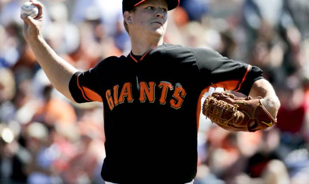 San Francisco Giants starting pitcher Matt Cain throws to the Chicago Cubs during the first inning of a spring exhibition baseball game in Scottsdale, Ariz., Monday, March 10, 2014. (AP Photo/Chris Carlson)
