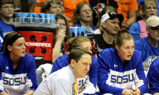 Aaron Johnson, head coach of the South Dakota State womans basketball team watches the action during their WNIT Final Four game against UTEP in El Paso, Texas, Wednesday April 2, 2014. (AP Photo/El Paso Times, Rudy Gutierrez)