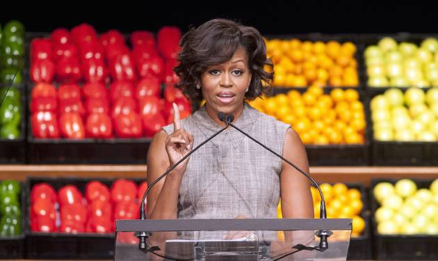 FILE - In this Jan. 20, 2011 file photo, first lady Michelle Obama takes part in Wal-Mart's announcement of a comprehensive effort to provide healthier and more affordable food choices to their customers, in Washington. Recent changes put in place by the food industry are in response to the campaign against childhood obesity that Obama began waging three years ago. (AP Photo/Cliff Owen, File)