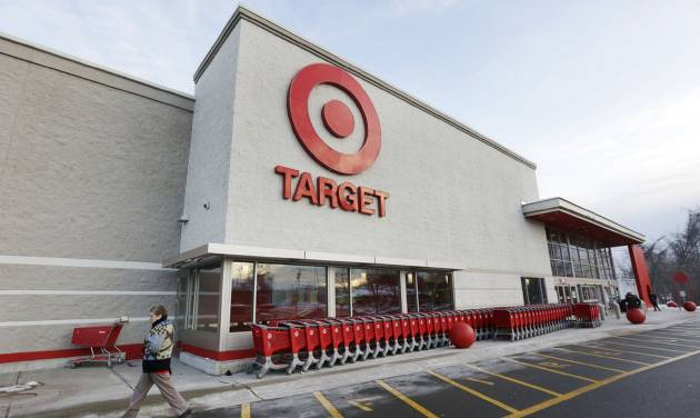 FILE - In this Dec. 19, 2013, file photo, a passer-by walks near an entrance to a Target retail store in Watertown, Mass. In a report released Wednesday, May 28, 2014, a prominent proxy advisory firm is recommending Target shareholders should vote against seven of the 10 directors for what it believes was failure to manage risk against a massive pre-Christmas data breach. (AP Photo/Steven Senne, File)
