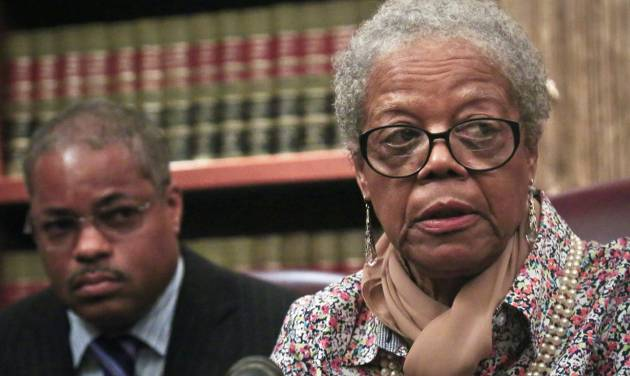 Attorney Derek Sells, left, listens as Alma Murdough speaks during a press conference on Friday May 16, 2014 in New York. Sells plans to file a $25 million wrongful death lawsuit against the city on behalf of Alma Murdough for the death of her son, Marine Jerome Murdough, who was found dead in a 100 degree cell on Rikers Island.  (AP Photo/Bebeto Matthews)