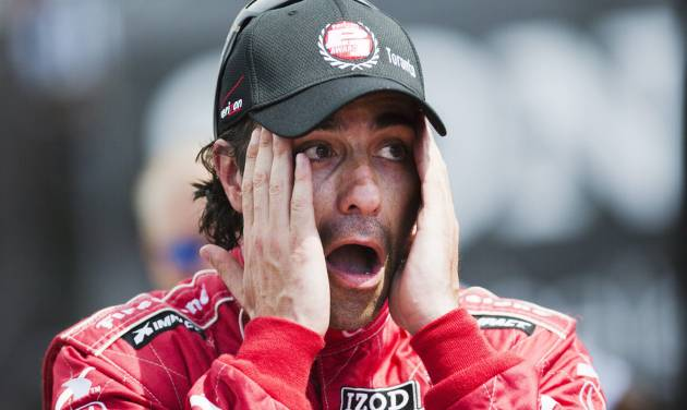 Dario Franchitti, of Scotland, wipes his face after winning the pole position for the first of two weekend IndyCar races, Friday, July 12, 2013 in Toronto. (AP Photo/The Canadian Press, Mark Blinch)